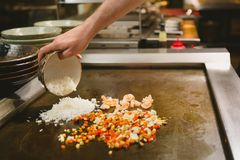 Chef cooking rice with vegetables and shrimp Stock Photos