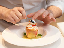 Chef is cooking a seafood appetizer Stock Photo