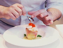 Chef is cooking a seafood appetizer, toned Stock Images
