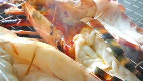 Chef Cooking seafood on barbeque grill. Grilled Giant River Prawn stock video