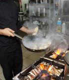 Chef is cooking seafood dish Royalty Free Stock Photography