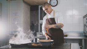 Chef cooking spaghetti in restaurant Royalty Free Stock Photography