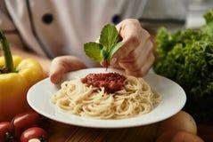 Chef cooking spaghetti Stock Photo