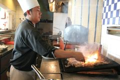 Chef cooking steak Royalty Free Stock Photography