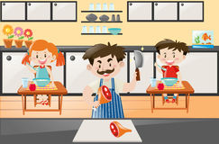 Chef cooking for two kids in kitchen Royalty Free Stock Photo