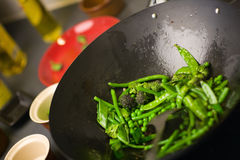 Chef cooking wok Royalty Free Stock Photography
