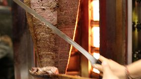 Chef cooks and cuts doner kebab which is the most popular fast food in Turkey stock footage