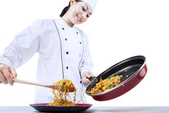 Chef cooks fried noodle Royalty Free Stock Image