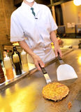 Chef cooks meat at restaurant Royalty Free Stock Photography