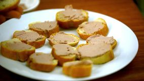 Chef cooks sandwiches with pate, tomatoes, sausage stock footage