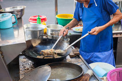 Chef cooks stir-fried noodles. At Kimberly Street Food Night Market in George Town, Penang, Malaysia royalty free stock image