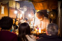 A Chef Cooks Yakitori in a Tokyo Street Restaurant at Night stock images