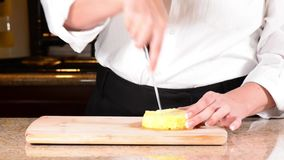 Chef coring pineapple slice stock footage