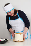 Chef covers cream cake Stock Images