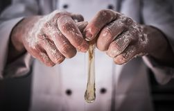Chef Cracking Eggs. In His Restaurant Kitchen. Making Crust. Closeup Photo Royalty Free Stock Photos