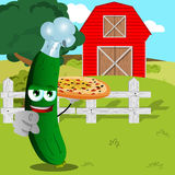 Chef cucumber or pickle with pizza pointing at viewer on a farm Royalty Free Stock Photography