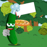 Chef cucumber or pickle with pizza pointing at viewer in the forest with speech bubble Stock Image