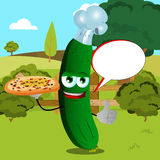 Chef cucumber or pickle with pizza showing thumb up on a meadow with speech bubble Stock Photos