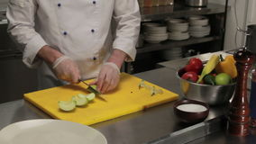 Chef curving an apple, medium shot stock video