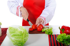 Chef cut the tomatoes Royalty Free Stock Photography