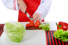 Chef cut the tomatoes Stock Photos