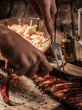 Chef cut up barbecue ribs. Stock Image
