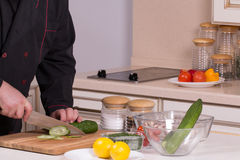 The chef cuts the cucumber Royalty Free Stock Photo