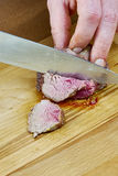 Chef cuts grilled meat on the board with a full series of blood recipe cooking Stock Images