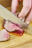 Chef cuts grilled meat on the board with a full series of blood recipe cooking Royalty Free Stock Image