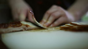 The chef cuts knife a fillet of smoked fish stock footage