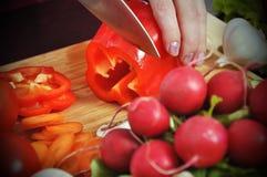 Chef cuts paprika Stock Image