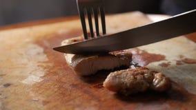 chef cuts steak