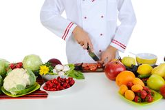 Chef cuts the vegetables Stock Photos