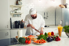 Chef cuts the vegetables to cook dinner Stock Images