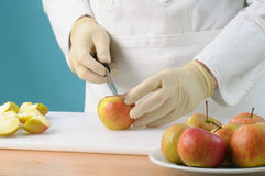 Chef cutting apples Stock Photos