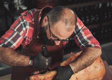 Chef cutting beef carcass in a restaurant
