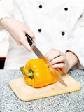 Chef cutting bell peppers Stock Photography