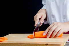 Chef cutting carrot Stock Photo