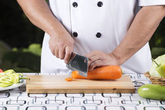 Chef cutting carrot Stock Photos