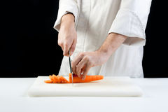 Chef cutting carrots Royalty Free Stock Photo