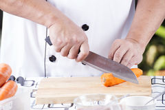 Chef is cutting carrots Stock Photos