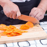 Chef is cutting carrots Royalty Free Stock Image