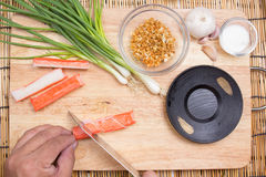 Chef cutting crab imitation Royalty Free Stock Images