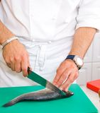 Chef cutting the fish Royalty Free Stock Photos
