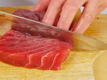 Chef cutting fresh Tuna Stock Photography
