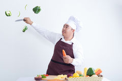 Chef cutting fresh vegetables in the air Stock Images