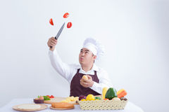 Chef cutting fresh vegetables in the air Stock Photo
