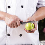 Chef cutting green apple Stock Image