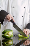 Chef Cutting Green Pepper Stock Images