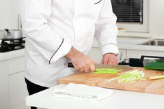 Chef cutting leek Royalty Free Stock Photography